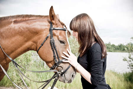 beautiful girl and her handsome horse.Friendship photo