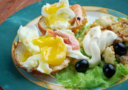Eggs Neptune. layered breakfast  dish consisting of  English muffin, poached eggs, and hollandaise sauce