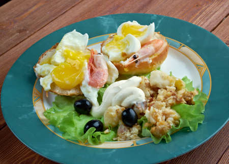 nack: Eggs Neptune. layered breakfast  dish consisting of  English muffin, poached eggs, and hollandaise sauce
