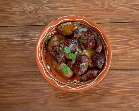 cypriot: Afelia - a traditional Greek and  Cypriot food. pork marinated and cooked in red wine