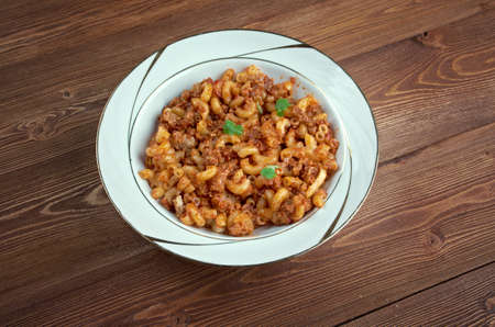 American goulash - dish baked as a casserole american pasta,beef as tomato sauce. photo