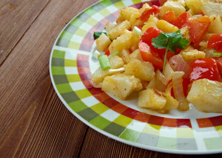 browns: Potatoes OBrien -  dish of pan-fried potatoes along with green and red bell peppers.