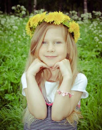 girl with dandelion.Beauty Girl in green meadow photo