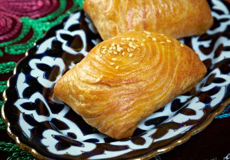 uzbek: traditional eastern food samsa - Uzbek cuisine