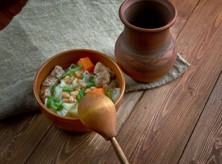 Ollada - traditional dish  in  Valencian.Spanish soup with pork ribs and vegetables photo