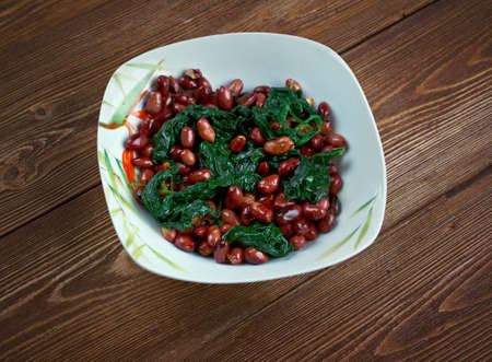 chinese spinach: Spinach with Peanuts - Chinese food close up Stock Photo