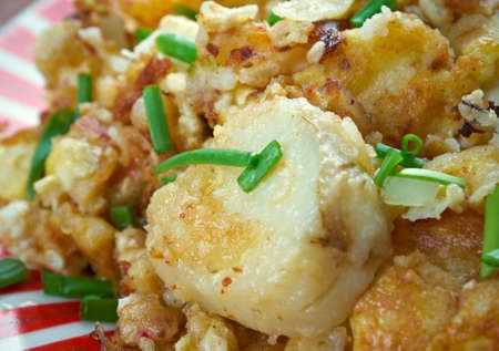 browned: Curried Hash Brown Scramble - crispy browned potatoes tossed sauteed onions, curry powder, and scrambled eggs