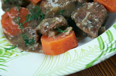 inexpensive: Daube stew - classic Provença  French stew made with inexpensive beef braised in wine, vegetables, garlic
