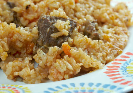 simultaneously: Chegdermeh - Turkmen traditional food is cooked simultaneously with rice,  lamb, tomato paste