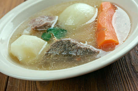 broth: Aberaeron Broth - Welsh-language. broth which consists of bacon, beef, parsnips, cabbage, leeks, carrots Stock Photo