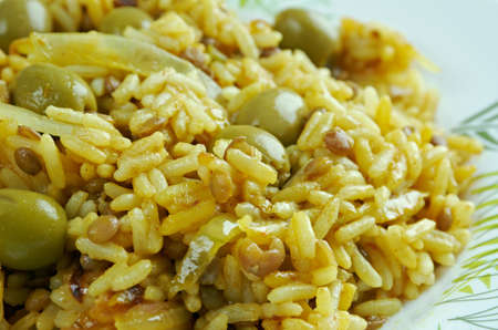 Arroz con gandules -  rice, pigeon peas . cooked  pot with Puerto Rican-style. popular throughout Latin America and the Caribbean. Stock Photo
