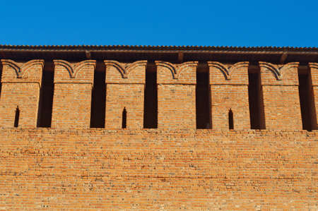 embrasure: Embrasure in the defense wall of red bricks of ancient city