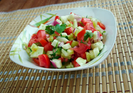 cuisines: Kachumbari -  fresh tomato and onion salad.  popular in  cuisines of  African Great Lakes region. Stock Photo