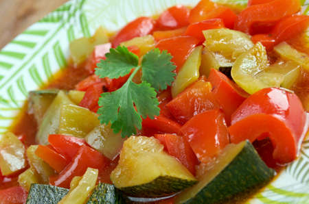 red peppers: Pisto -  Spanish dish . made of tomatoes, onions, eggplant or courgettes, green and red peppers and olive oil
