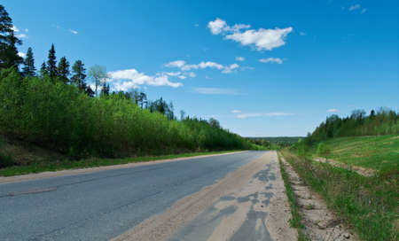 streight: Russian rural landscape with road  Distance in Forest. Stock Photo