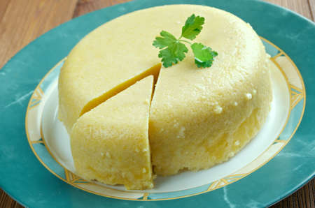 maize flour: Mamaliga -  porridge made out of yellow maize flour, traditional in Romania, Moldova, and Western Ukraine.