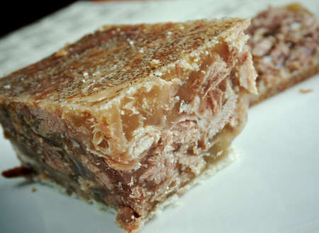 cold cut: Jellied veal - cold cut dish made from veal, sometimes pork, stock, onion and spices such as allspice.traditional dish for Christmas in Sweden Stock Photo