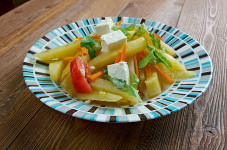 starchy food: haystak food - dish composed of a starchy food  in combination with fresh vegetables Stock Photo
