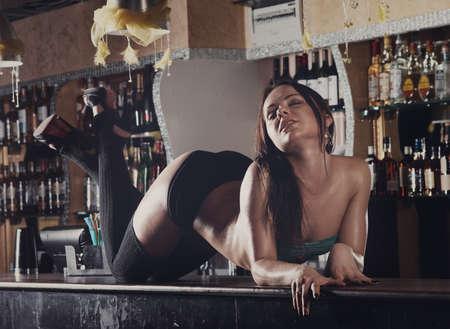 dancing club: young pretty women dancing on bar night club Stock Photo