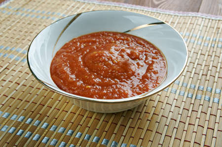 tomato paste: Zacusca - vegetable spread popular in Romania. ingredients are roasted eggplant, sauteed onions, tomato paste, and roasted red peppers Stock Photo