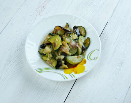 italian dish: berenjena a la vinagreta - Italian dish with eggplant and vegetables