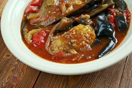 iraqi: Tepsi Baytinijan-  popular Iraqi casserole .dish is aubergine,baking dish, accompanied with meatballs, tomatoes, onions and garlic. Stock Photo