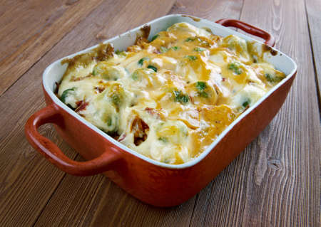 vegtables: Homemade Chicken Divan - chicken casserole served with almonds, and Mornay sauce
