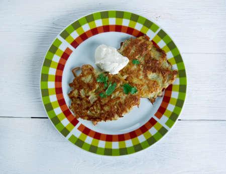 jews: Potato pancake  latkes  - raditionally eaten by Ashkenazi Jews during the Hanukkah festival