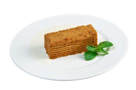 napoleon: cake Napoleon on a white plate.close up