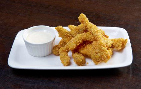 crunchy: crunchy fish sticks. close up