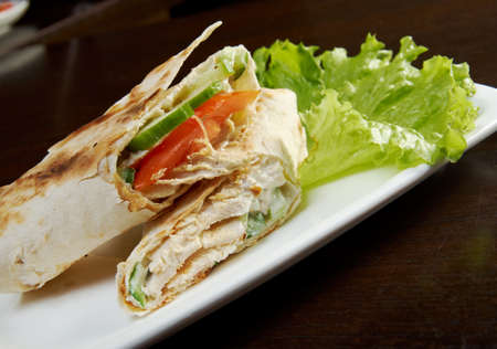 tast: Roll, strudel from pancakes, crepes with cheese, creamy tast Stock Photo