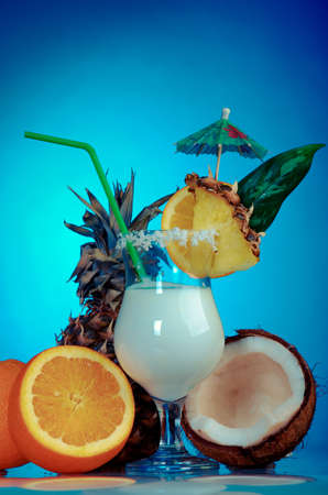 liqueurs: Pina Colada - Cocktail with Cream, Pineapple Juice and Rum on blue