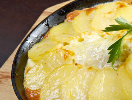 plaice: sea bass in tagine.Baked potatoes with sour cream