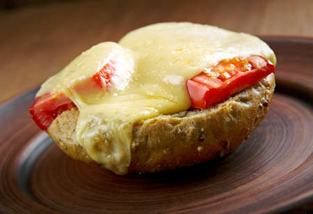 uk cuisine: Irish rarebit - dish made with a savoury sauce of melted cheese of toasted bread.British cuisine Stock Photo