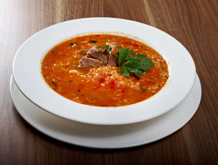 eating meat: Soup Kharcho, traditional Georgian soup with meat and rice Stock Photo