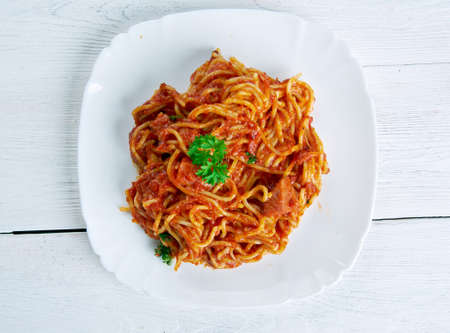 tabasco: Naporitan - Japan dish consists of spaghetti, tomato ketchup., green peppers, sausage, bacon and Tabasco sauce Stock Photo