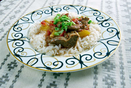 homestyle: Alinazik kebab - home-style Turkish dish . topped  cubes of sauteed lamb,  served with rice pilaf. Stock Photo