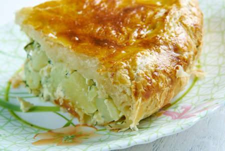 aux: Pate aux pommes de terre   speciality of the Limousin and the Allier . main ingredients are potato slices and crème fraîche, which are used to fill a puff pastry crust.