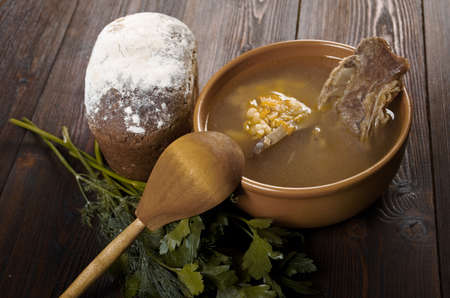 homestyle: Pea soup with beef ribs  and farmhouse bread,edible greens .farmhouse kitchen