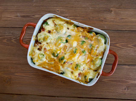 vegtables: Homemade Chicken Divan - chicken casserole served with almonds, and Mornay sauce.  American cuisine Stock Photo