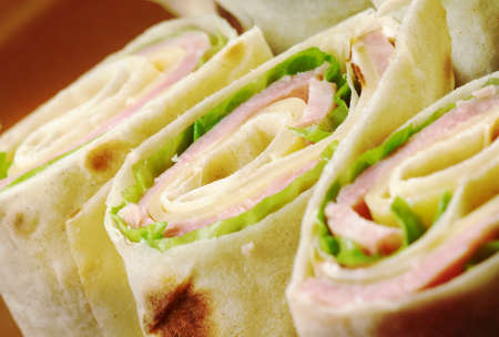 toasted sandwich: healthy club sandwich pita bread roll with cheese,ham,parsley Stock Photo