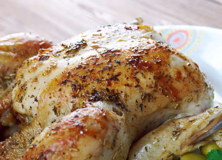french cuisine: Poulet Garni  - roasted chicken with herbs. French cuisine