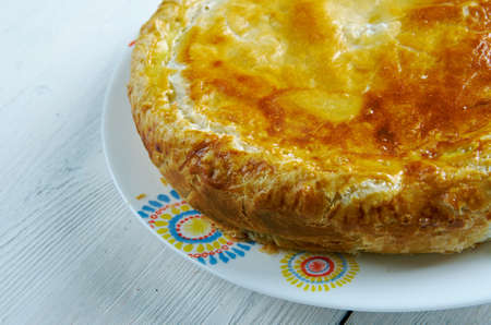 aux: Pate aux pommes de terre   speciality of the Limousin and the Allier . main ingredients are potato slices and crème fraîche, which are used to fill a puff pastry crust. Stock Photo