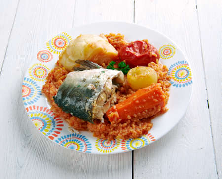 Thieboudienne - traditional dish from Senegal.made from fish, rice and tomato sauce