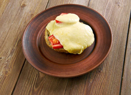 lunch tray: Irish rarebit - dish made with a savoury sauce of melted cheese of toasted bread.British cuisine Stock Photo