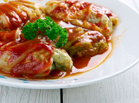 vegetarian cuisine: Sarma -  dish of grape, cabbage, monks rhubarb or chard leaves rolled  . cuisines of former Ottoman Empire from the Middle East to the Balkans and Central Europe. Stock Photo