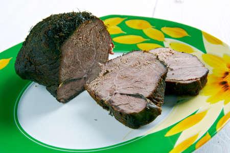 venison: Poronpaist - chopping freshly baked venison. Stock Photo