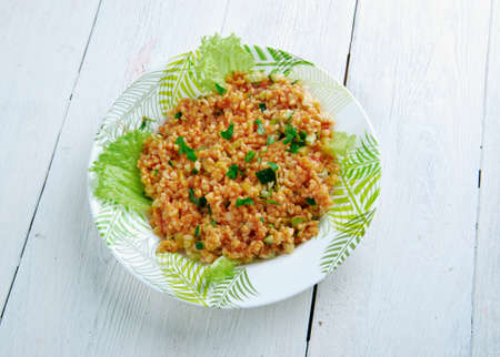 tomato paste: K%u0131s%u0131r - traditional side dish in Turkish cuisines. main ingredients are finely ground bulgur, parsley, and tomato paste.