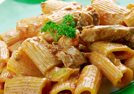 sweet peppers: Chicken riggies -  Italian-American pasta dish.area of New York State.consisting of chicken, rigatoni and hot or sweet peppers in a spicy cream and tomato sauce.