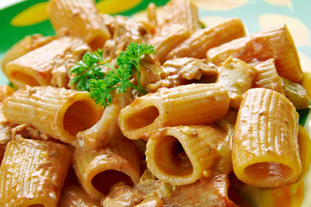 pasta: Chicken riggies -  Italian-American pasta dish.area of New York State.consisting of chicken, rigatoni and hot or sweet peppers in a spicy cream and tomato sauce.